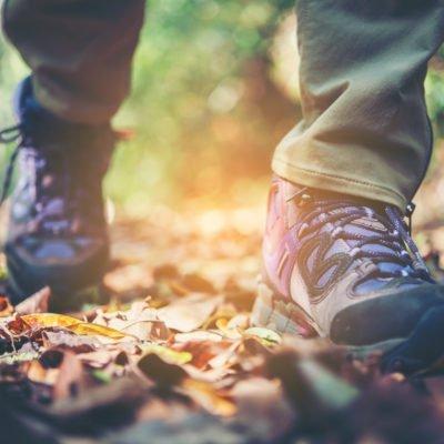 close up adventure woman feet walk mountain path